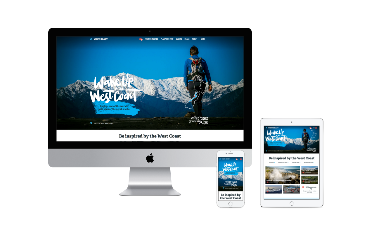 mockup design of west coast tourism website on serval different sized devices